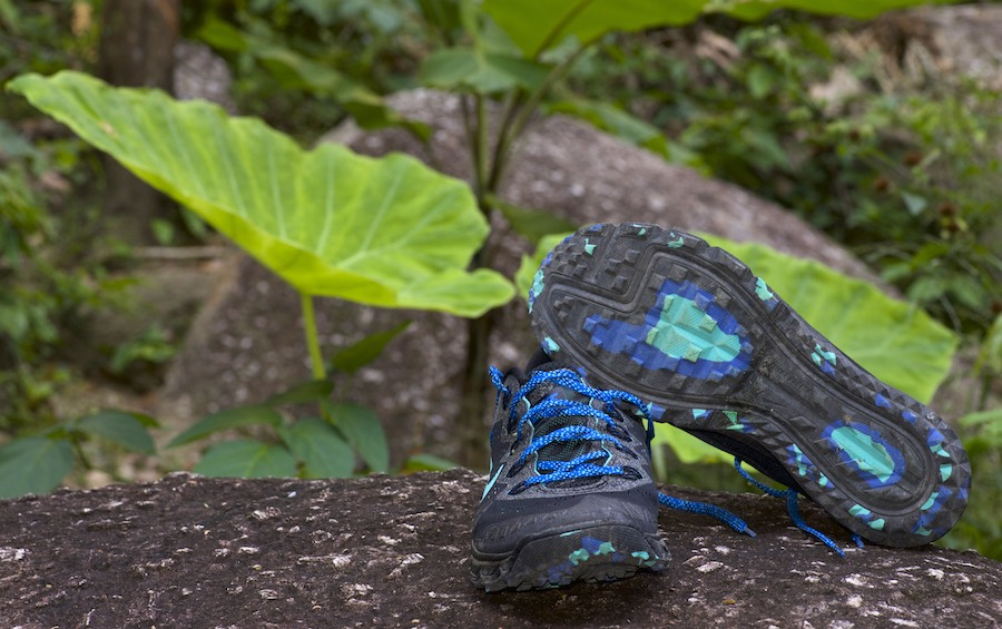 Zoom Terra Kiger v2 shoes on a rock beside a Thailand running trail.