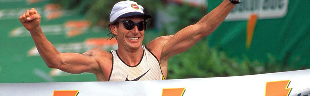 Mark Allen, one of the world's top triathletes in the 1980's, finishes a triathlon with a smile.