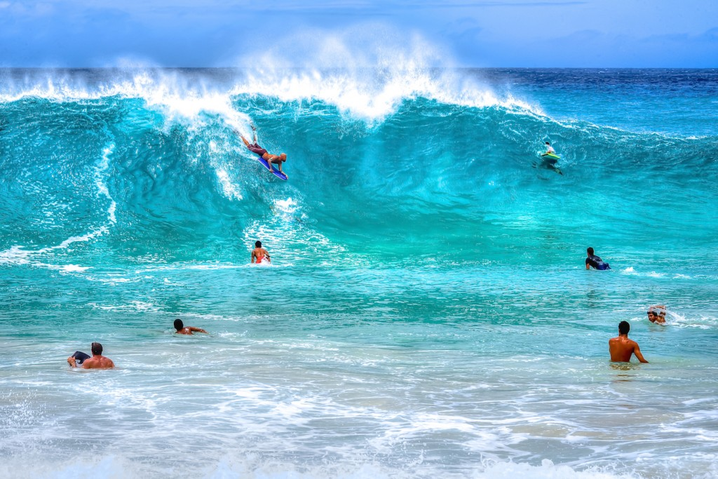 Bodyboarding as exercise in Hawaii - promotes good anaerobic capacity, strength, and yet it is a bit dangerous as you can guess.